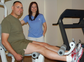 Physical therapy assistant Kevin Callahan, PTA, left, treats the ankle of Brian Edwards